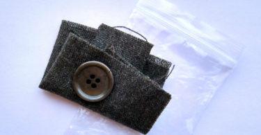 Лоскутки ткани, прилагающиеся к новой одежде